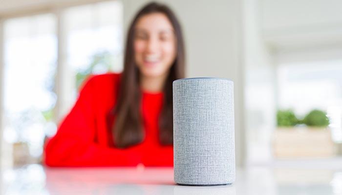Lady talkingto a smart speaker