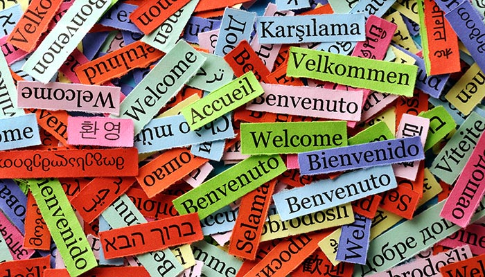 Welcome tags written in multiple languages scattered over each other